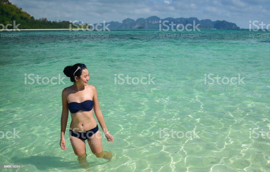 Asian woman travel with bikini on summer beach stock photo