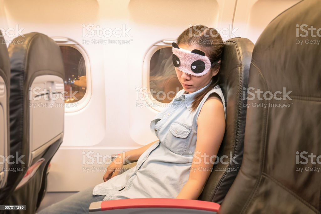 Asian woman traveller sleeping in the airplane stock photo