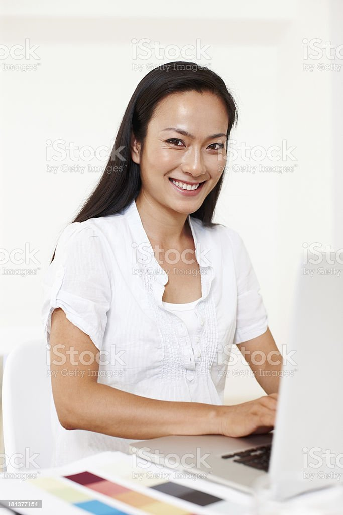 Asian woman using a laptop royalty-free stock photo