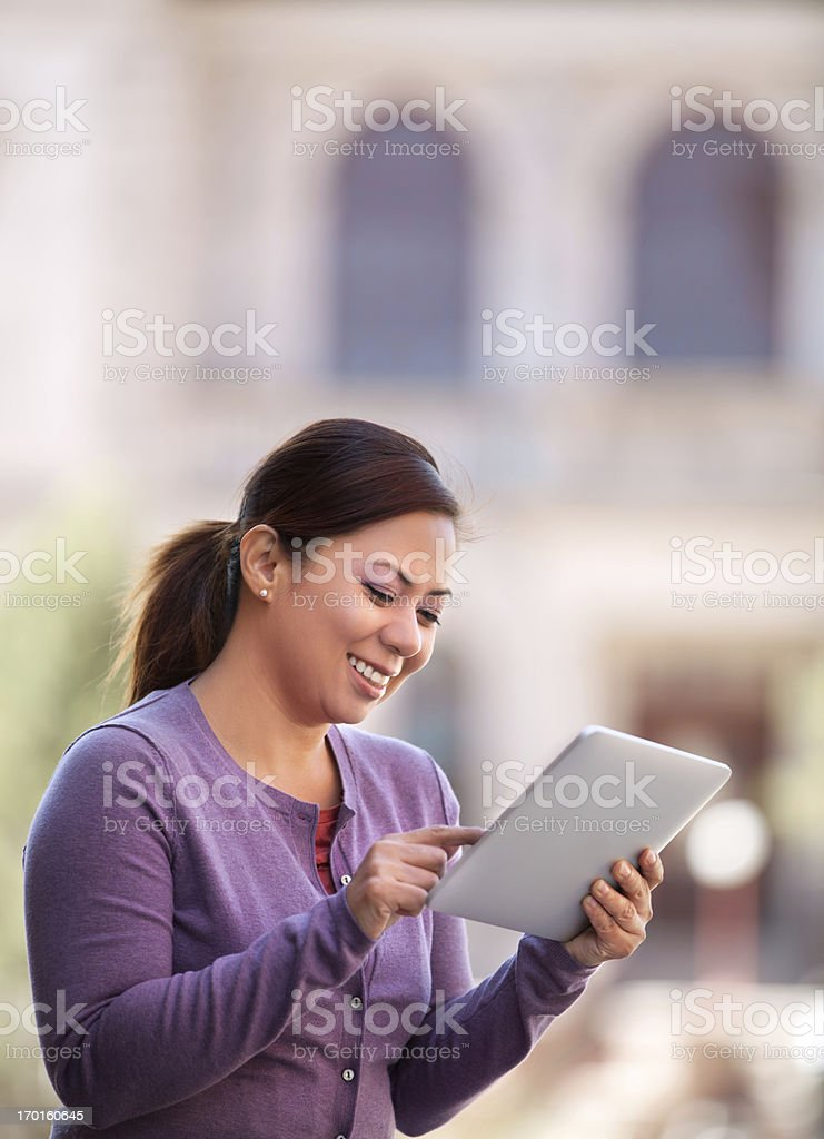 Asian Woman Using Digital Tablet Outdoor royalty-free stock photo