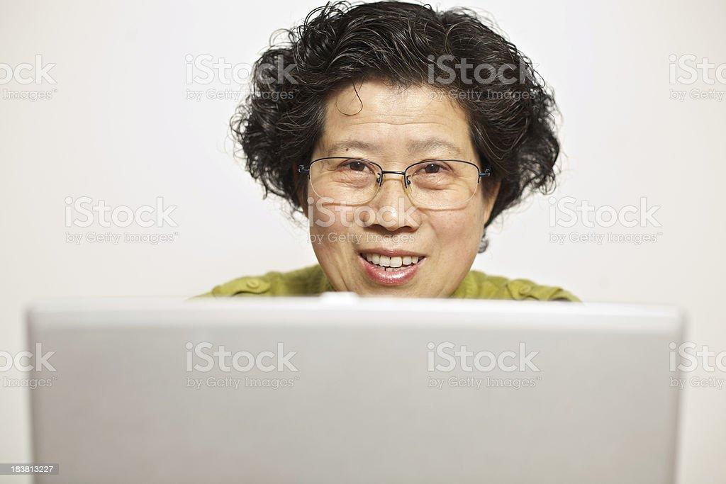 Asian woman using laptop stock photo