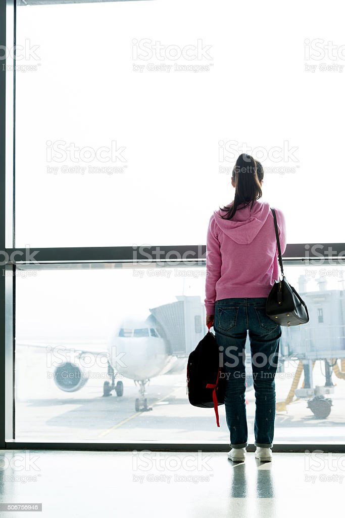 Asian woman waiting at the airport stock photo