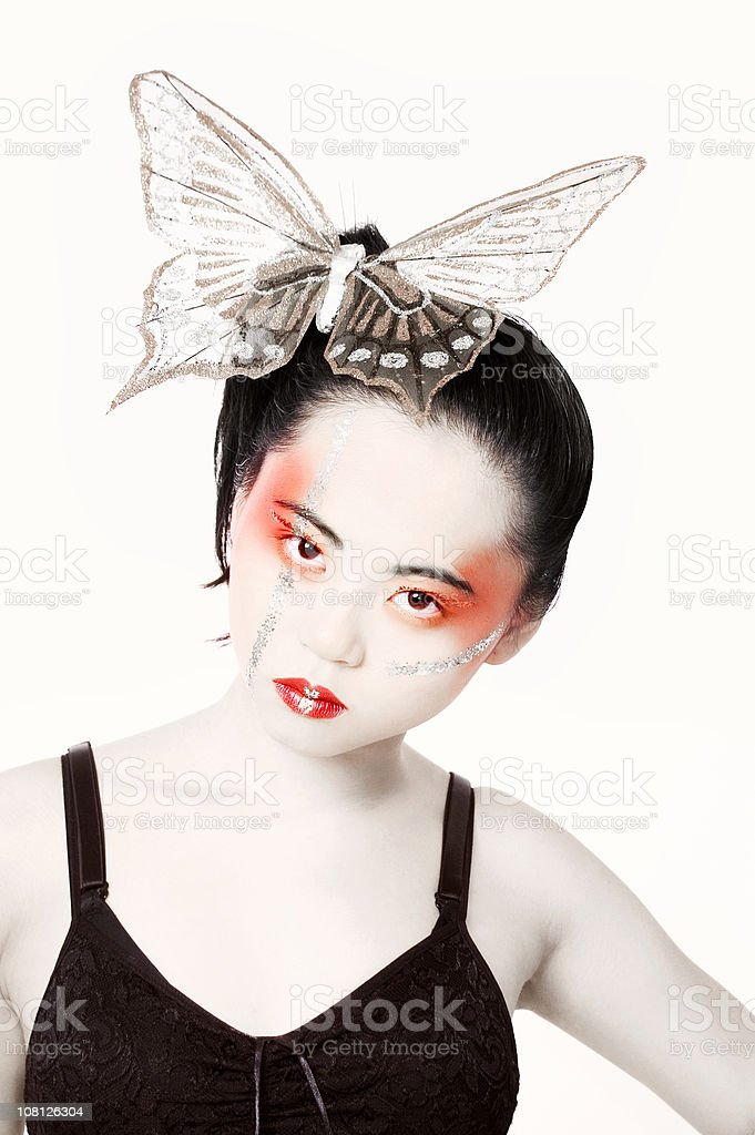 Asian Woman Wearing Butterfly in Hair royalty-free stock photo