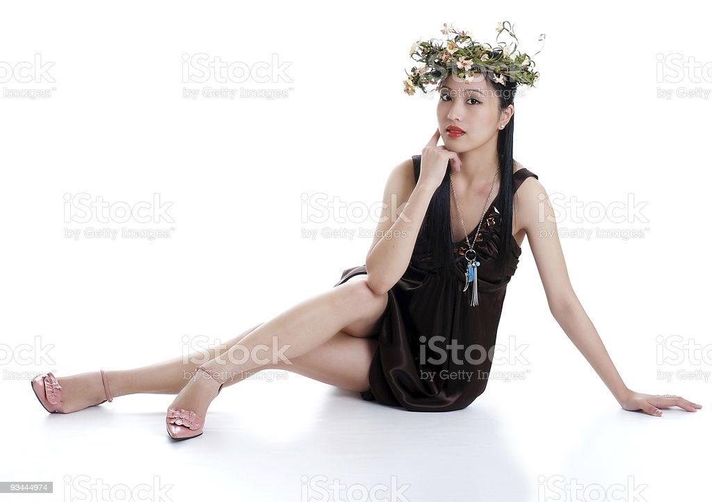 oriental woman wearing flowers isolated royalty-free stock photo