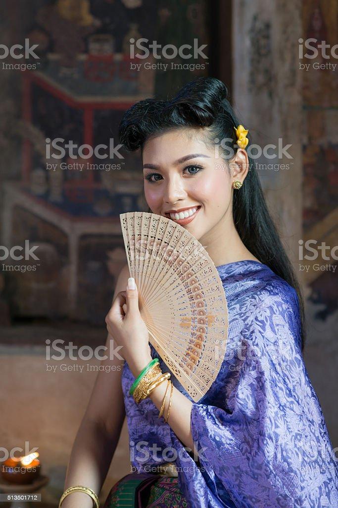 Asian woman wearing typical thai dress. stock photo