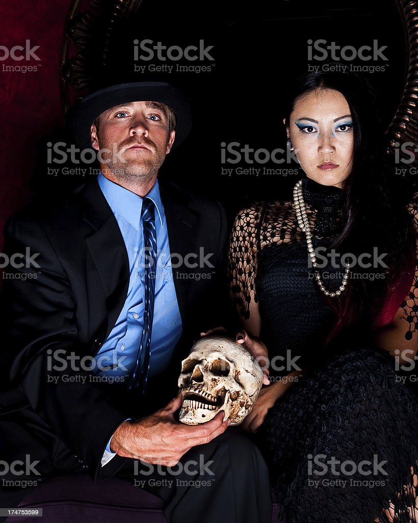 Asian Woman with a Skull royalty-free stock photo