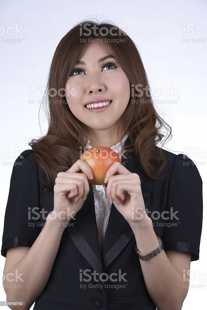 Asian woman with an apple stock photo