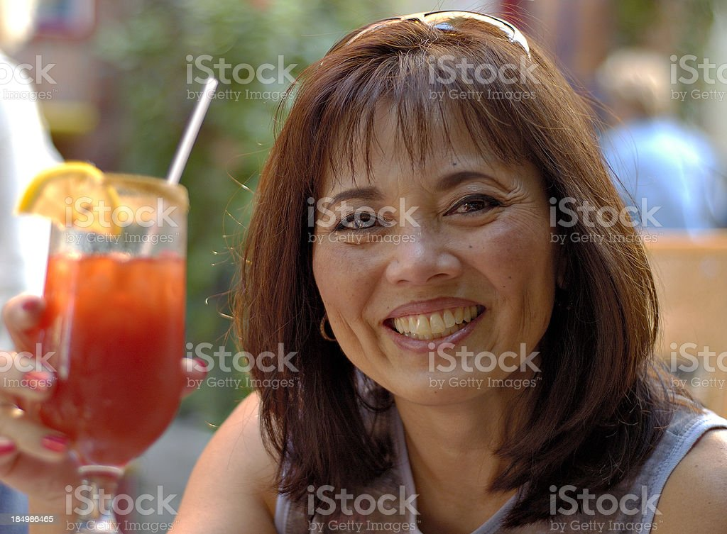Asian woman with drink. royalty-free stock photo