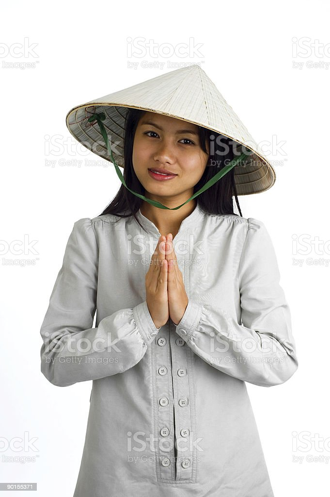 Asian woman with hands together in welcome stock photo
