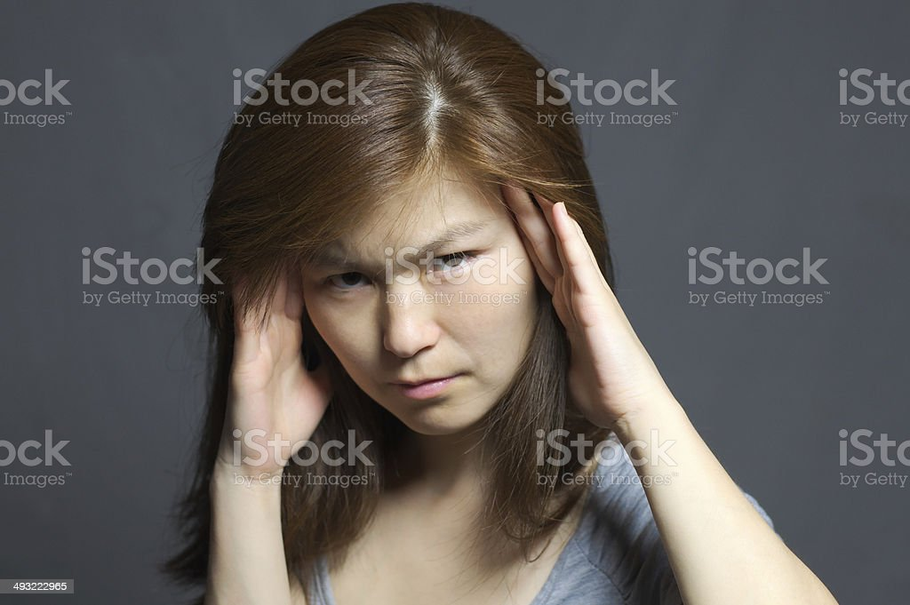 Asian woman with headache stock photo