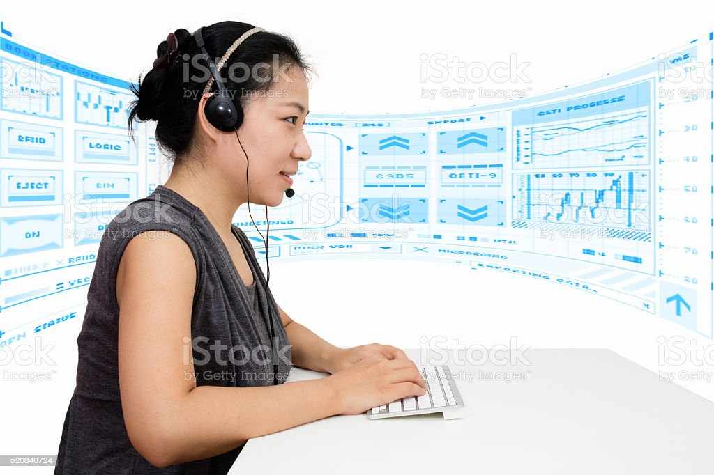 Asian Woman with Headset Using Keyboard stock photo