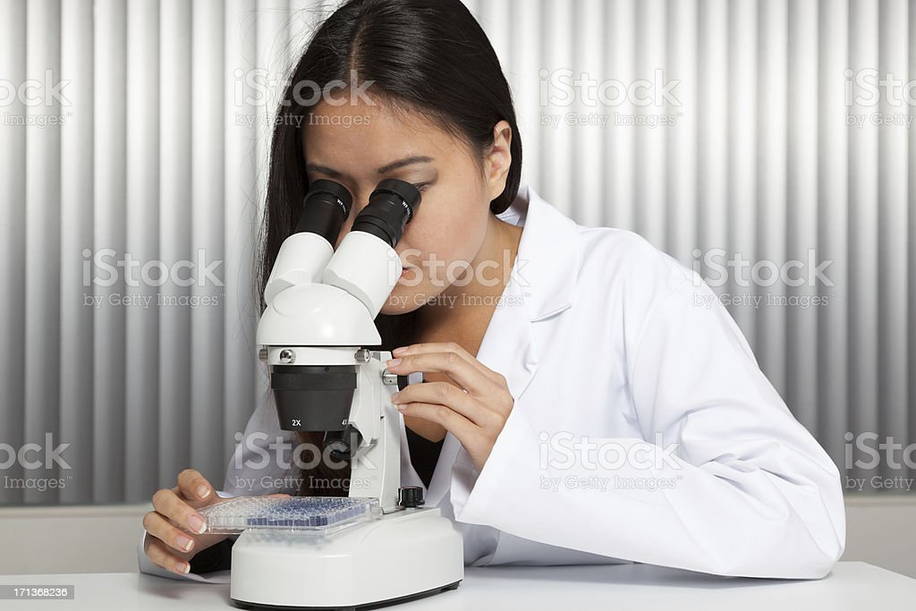 Asian woman with microscope stock photo