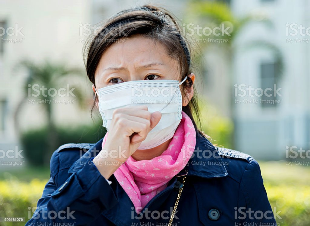 Asian woman with protective mask stock photo