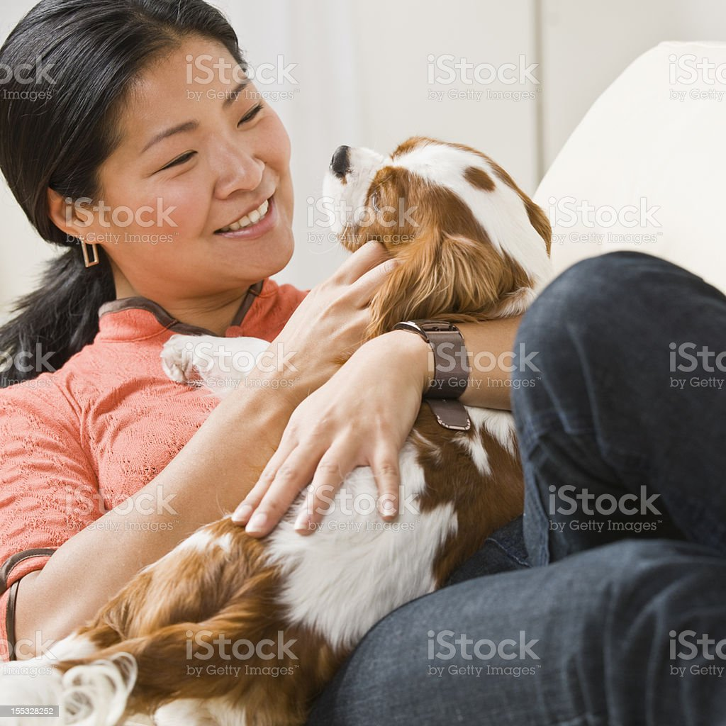 Asian Woman With Puppy stock photo