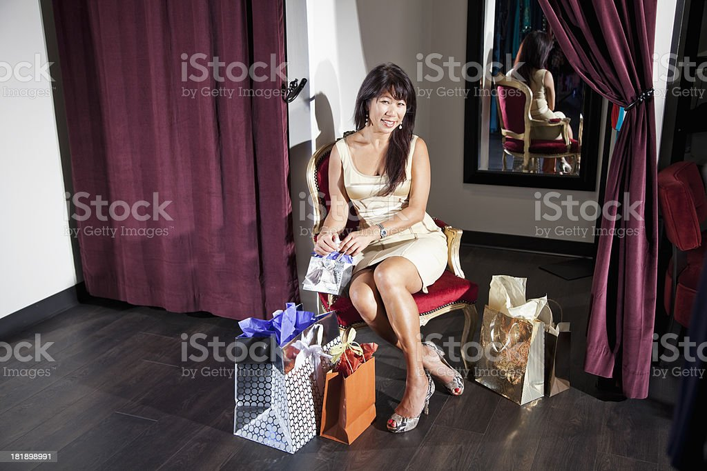 Asian woman with shopping bags stock photo
