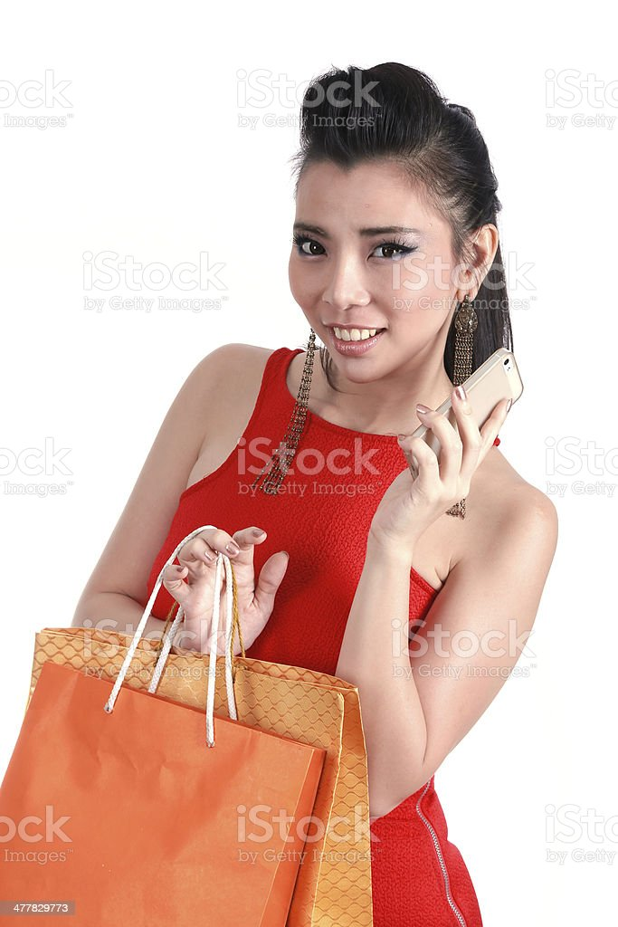 Asian woman with shopping bags royalty-free stock photo