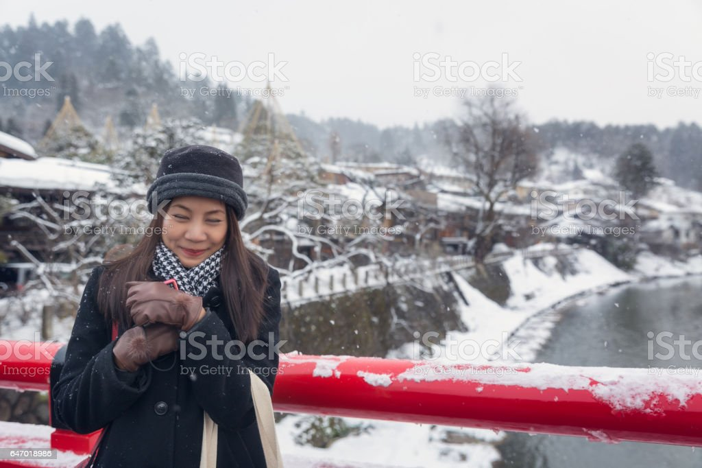 Asian woman with winter coat in winter day stock photo