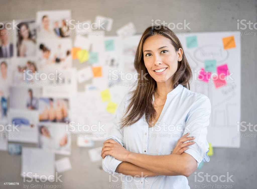 Asian woman working at a creative office stock photo