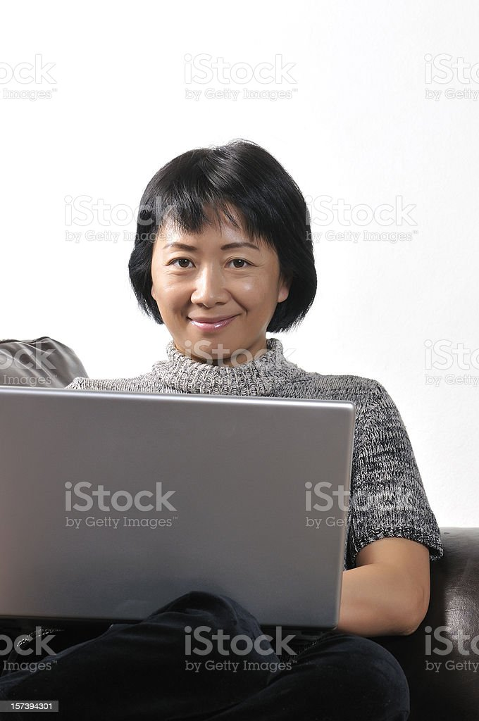 Asian woman working from home royalty-free stock photo