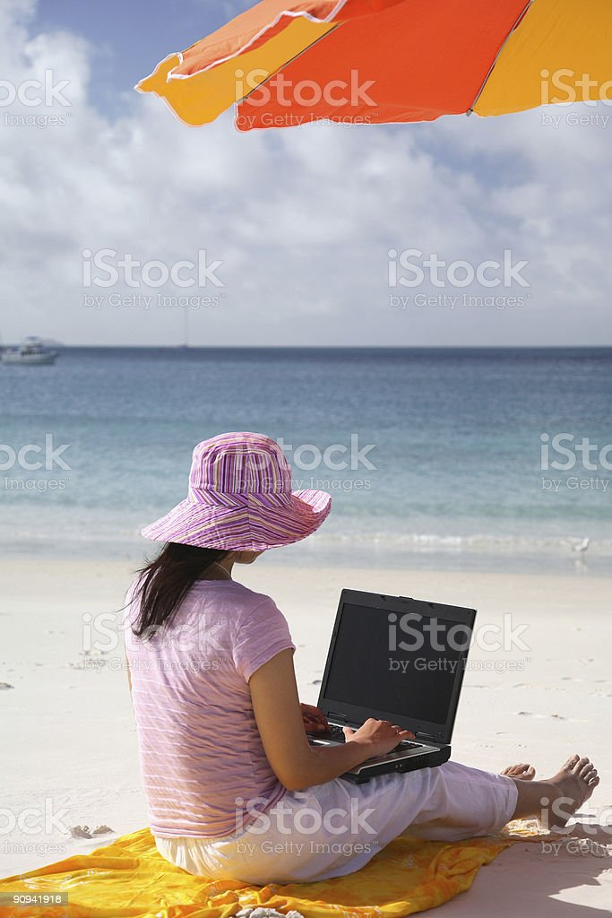 Asian Woman working on the beach royalty-free stock photo