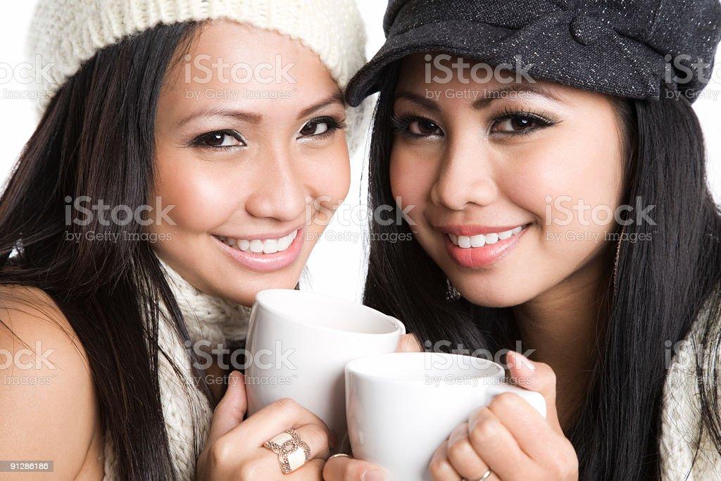 Asian women drinking coffee royalty-free stock photo
