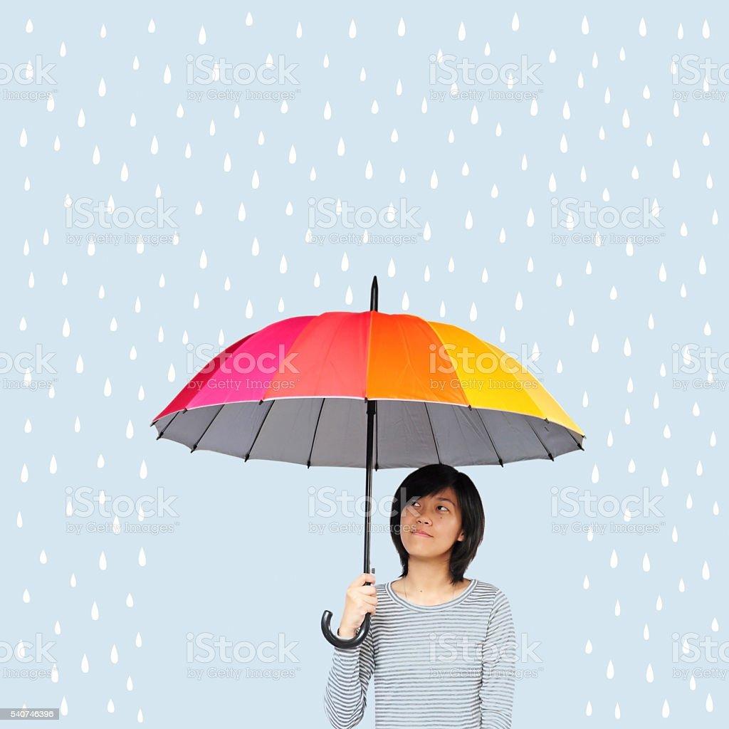 Asian women holding umbrella stock photo