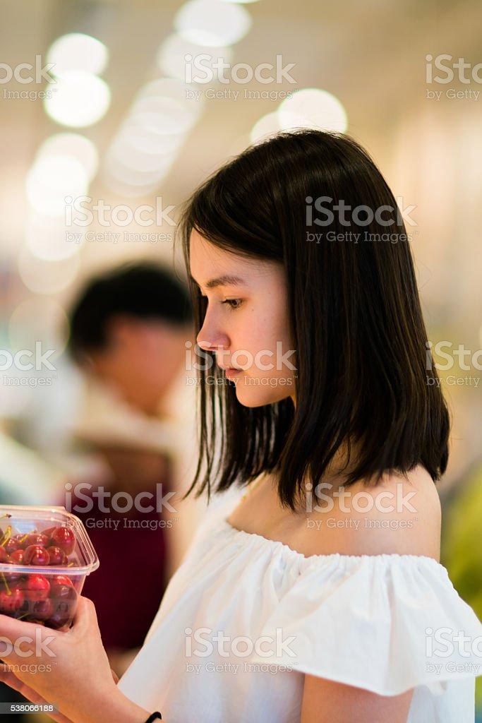 Asian women in supemarket stock photo