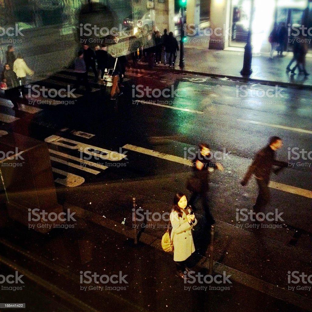 Asian Women on Paris street holding mobile phone stock photo