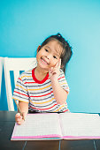 asian young girl children happy doing her homework people