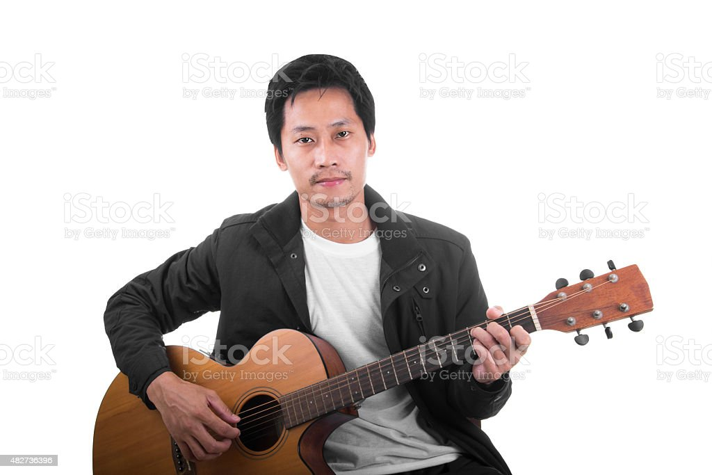 Asian Young Guitarist royalty-free stock photo