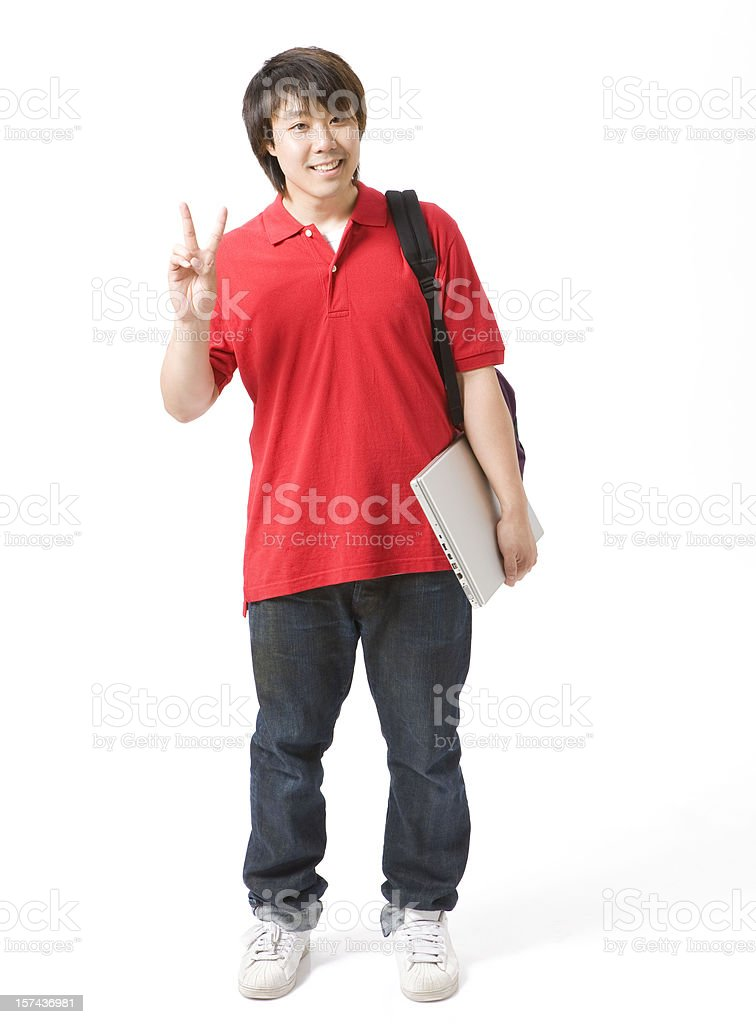 Asian young man giving peace sign royalty-free stock photo