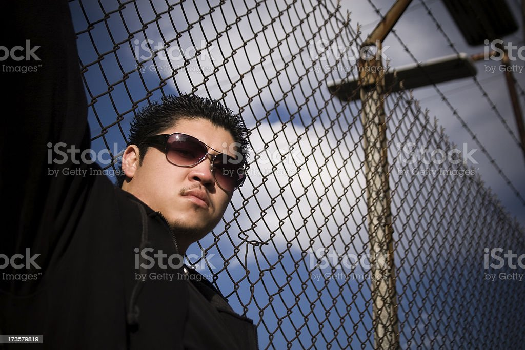 Asian Young Man Hip Hop Portrait Against Urban Fence, Copyspace royalty-free stock photo