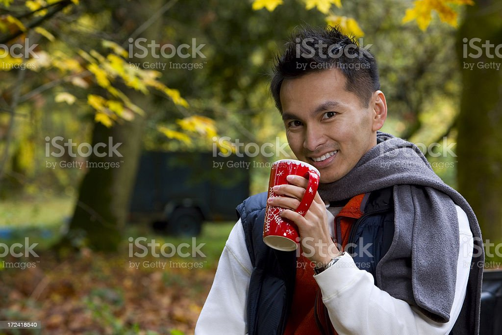 Asian Young Man Holding Coffee Mug on Fall Day, Copyspace royalty-free stock photo