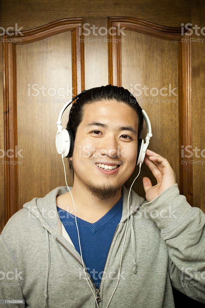 Asian young man listening to music royalty-free stock photo