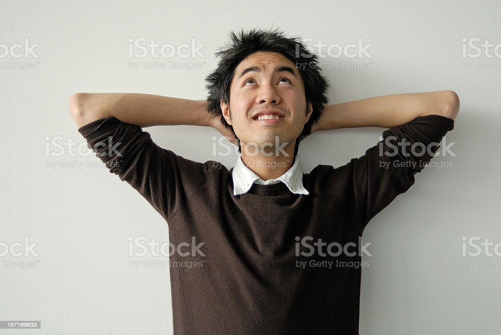 asian young man looking up royalty-free stock photo