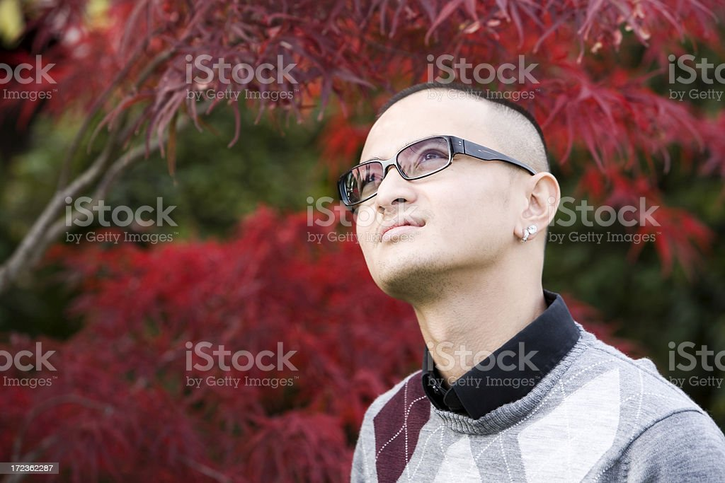 Asian Young Man Outdoors Looking Up at Sky, Copy Space royalty-free stock photo