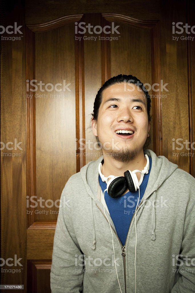 Asian young man smiles royalty-free stock photo