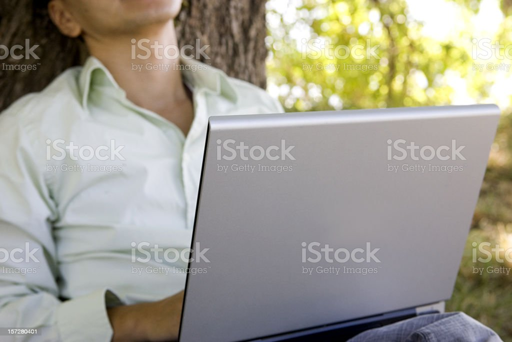 Asian Young Man Using Laptop Outdoors, Close Up, Copy Space royalty-free stock photo