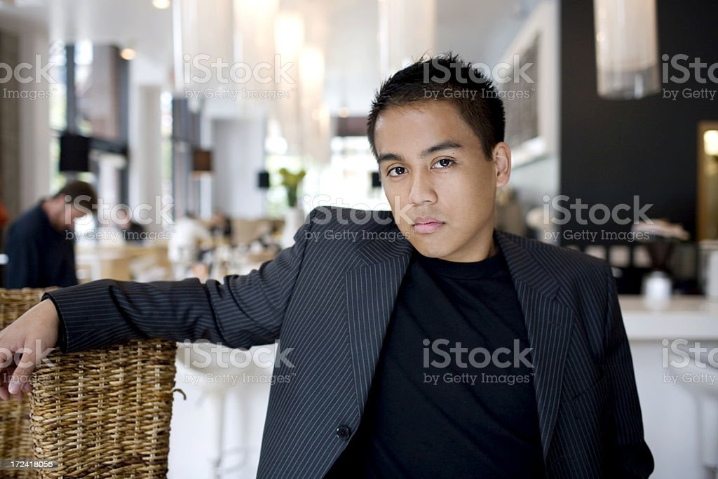 Asian Young Man Wearing Suit in Urban Restaurant, Copy Space royalty-free stock photo