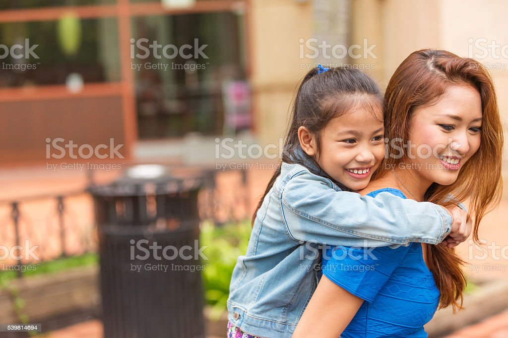 Asian Young Mother and Child Playing stock photo