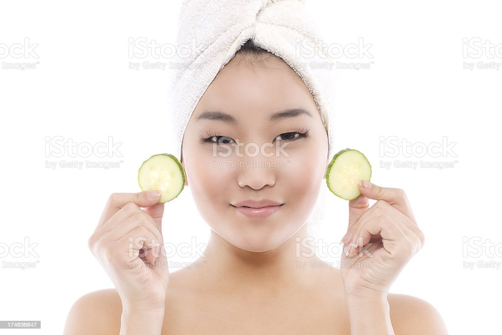 Asian Young Woman Beauty Model with Towel, Cucumber on White royalty-free stock photo