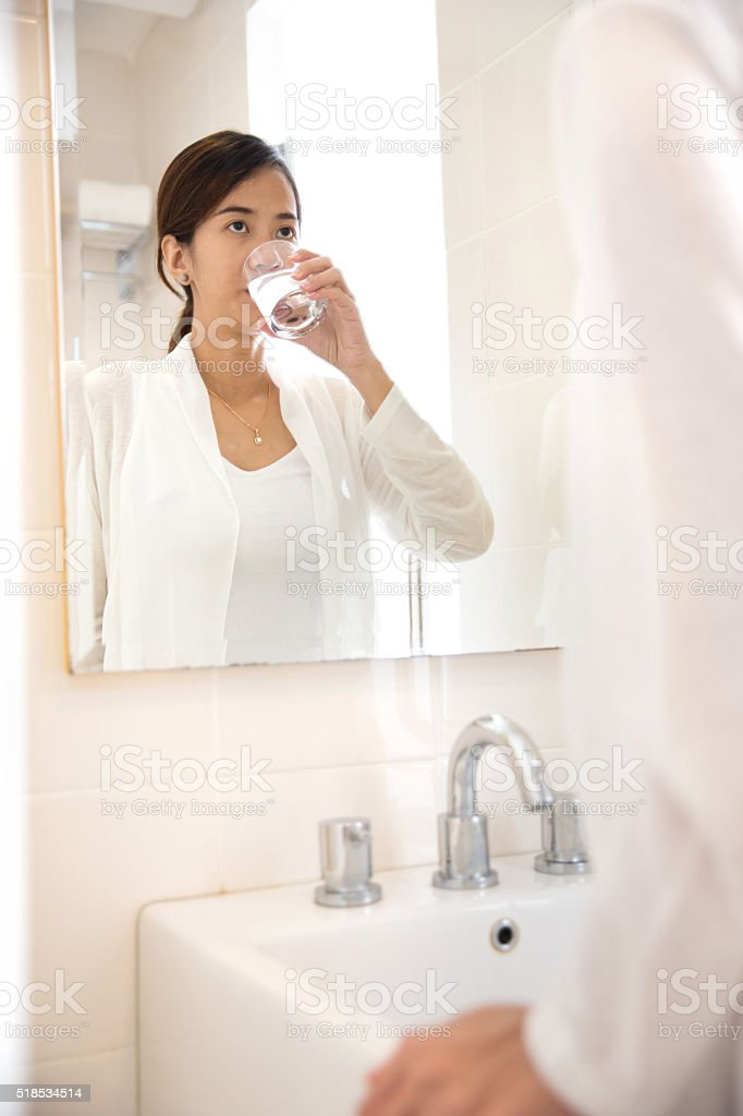 Asian young woman gargle on her mouth after tooth brushing stock photo