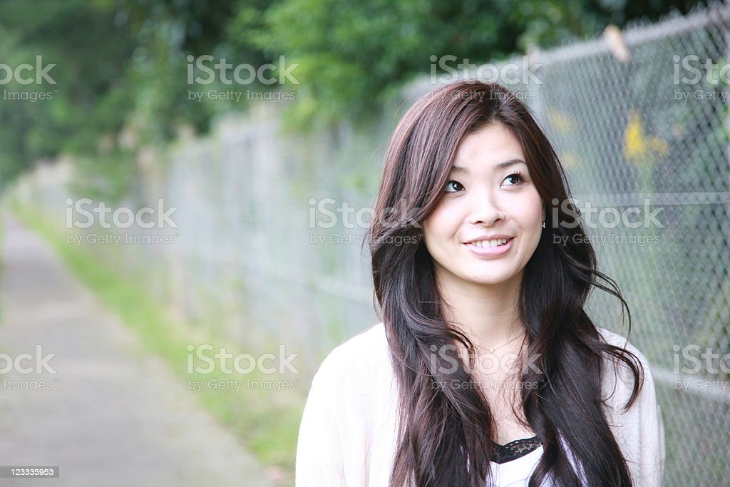 Asian young woman looks up royalty-free stock photo
