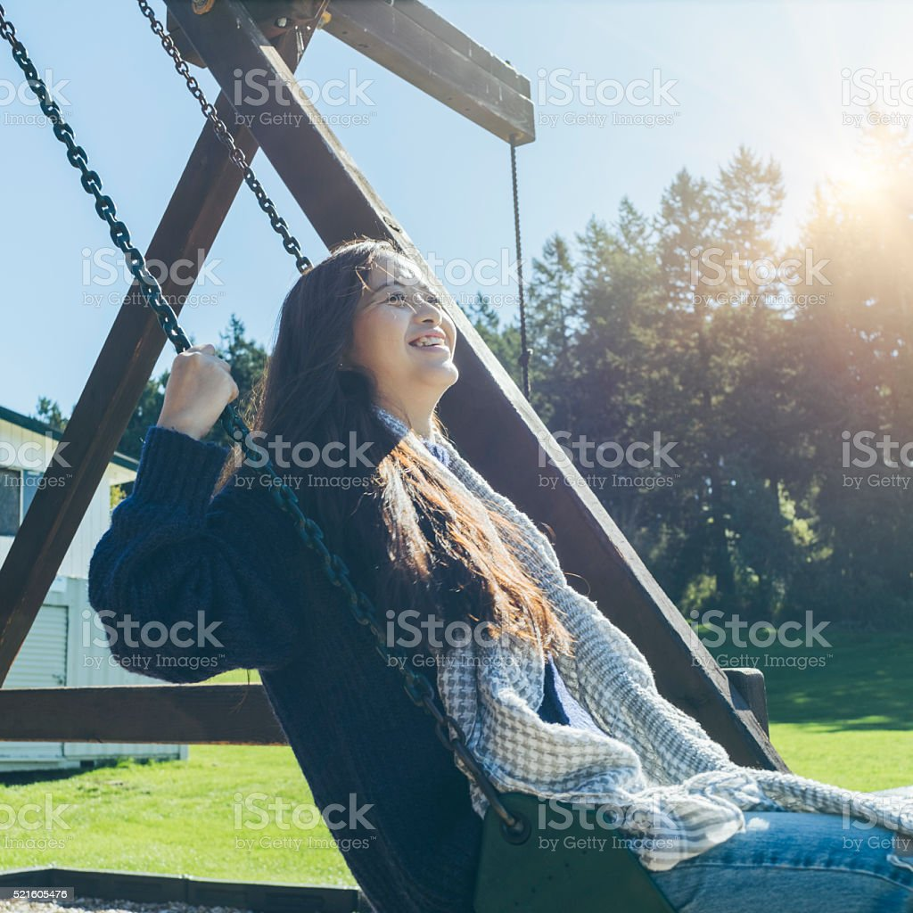 asian Young Woman Playing on a Swing stock photo