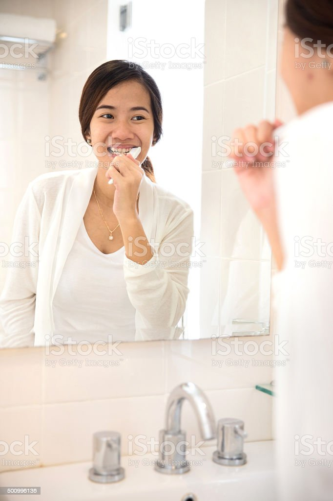 Asian young woman tooth brushing her teeth happily stock photo