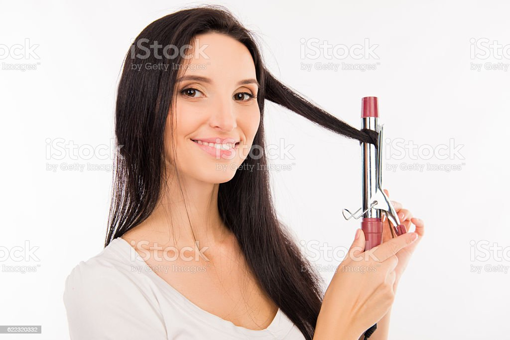 asian young woman  twists her hair curling on stock photo