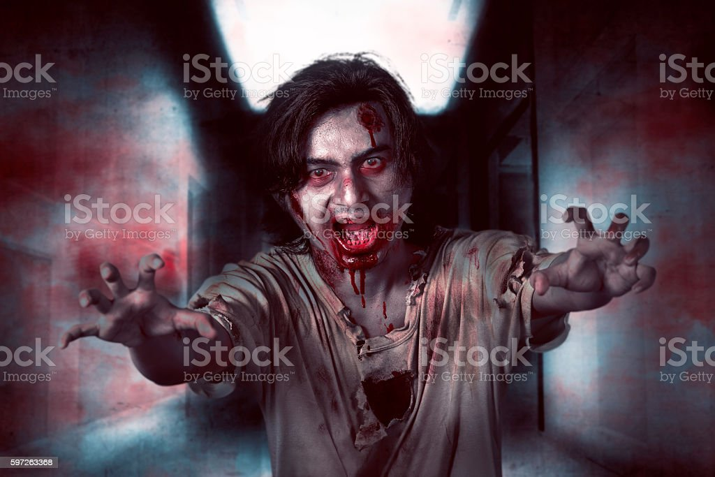 Asian zombie man in the empty room stock photo