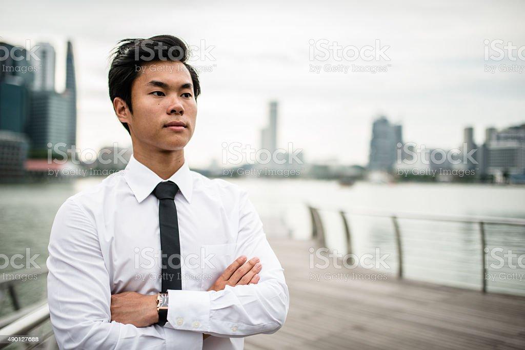 Asiatic Businessmen standing in Singapore stock photo