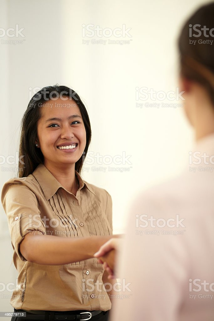 Asiatic executive woman giving hands greeting stock photo