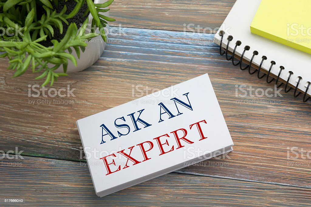 Ask an expert. Business card with message, notepad and flower stock photo